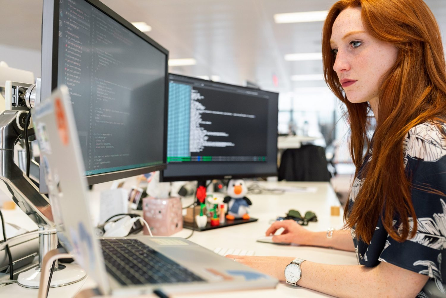 woman writing software code